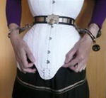 Aarkeybabble : Forced into a locking corset, consensually and probably loving it... kinda