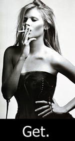 Aarkeybabble : Kate Moss smoking with her hand on her hip, while wearing a corset - I get